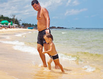 Father and son swimming in the sea Stock Image