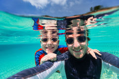 Father and son swimming Stock Image