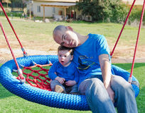 Father and Son on a swing. Father and Son bonding on a swing stock photos
