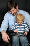 Father and son with tablet pc Royalty Free Stock Image