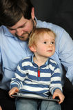 Father and son with tablet pc Stock Photo