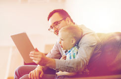 Father and son with tablet pc playing at home Royalty Free Stock Photo
