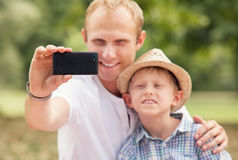 Father with son take self photo Stock Images