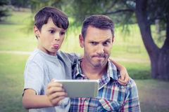 Father and son taking a selfie in the park Stock Photography