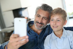 Father and son taking selfie Stock Photography