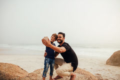 Father and son taking selfie at the rocky beach stock images