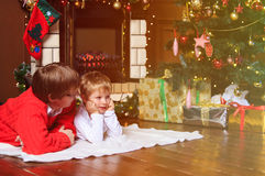 Father and son talking by a fireplace on Christmas Stock Photos