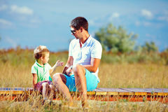 Father and son talking, summer. Outdoor stock image