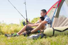 Father and son beside tent Stock Photography