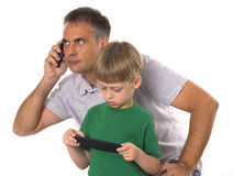 Father and son with their gadgets Stock Photo