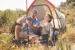 Father and son beside their tent in the countryside Stock Images