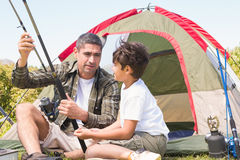 Father and son by their tent Royalty Free Stock Image