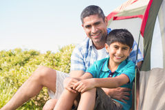 Father and son beside their tent Royalty Free Stock Image