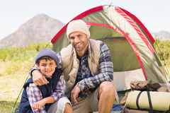 Father and son by their tent Royalty Free Stock Photography