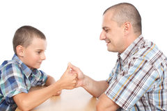 Father and son thumb wrestling Royalty Free Stock Image