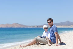 Father and son together Stock Images