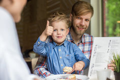 Father and son together in cafe. Family. Father's Day Stock Image