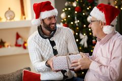 Father and son together celebrate Christmas. At home Stock Photos