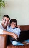 Father and son together with a computer Stock Photo
