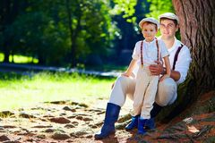 Father and son together enjoying nature Stock Photo