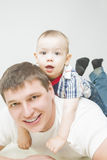 Father and son together on floor Stock Photos