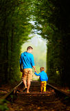 Father and son together in green tunnel. Father and son together in railway green tunnel stock images