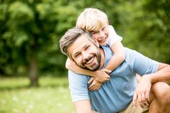 Father and son together. Happy father and son together hugging in summer Royalty Free Stock Image