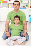 Father and son together at home Stock Photos