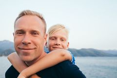 Father and son hugging. Father and son together. Son hugging father. Summer vacation royalty free stock image