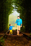 Father and son together in railway green tunnel Stock Photography