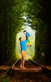 Father and son together in railway green tunnel Royalty Free Stock Images