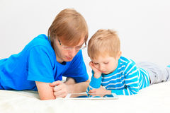 Father and son with touch pad at home Royalty Free Stock Photo