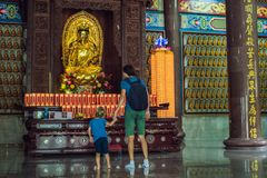 Father and son tourists in Buddhist temple Kek Lok Si in Penang, Malaysia, Georgetown. Traveling with children concept.  stock photos