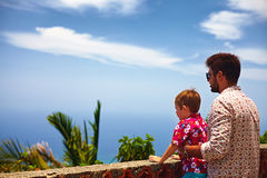 Father and son, tourists enjoying the fascinating view on Atlantic ocean coastline from observation deck Stock Photo