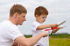 Father and son with toy aircraft in park Stock Photos