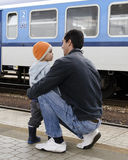 Father and son at train station Royalty Free Stock Images