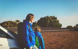 Father and son travel by car on the road Stock Photo