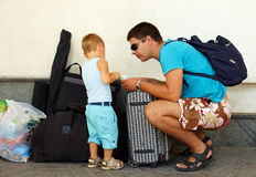 Father and son travel with huge luggage. Family adventures Stock Photo