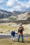 Father and son travel together in autumn mountains Durmitor, Mon. Father and son travel in autumn mountains Durmitor, Montenegro royalty free stock images