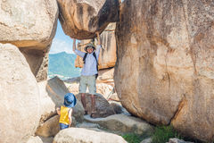 Father and son travelers at the Hon Chong cape, Garden stone, popular tourist destinations at Nha Trang. Vietnam Royalty Free Stock Photography