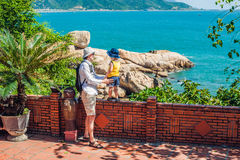 Father and son travelers look at Hon Chong cape, Garden stone, popular tourist destinations at Nha Trang. Vietnam. Asia Travel concept. Journey through Vietnam Royalty Free Stock Images