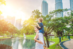 Father and son travelers in Malaysia against a background towers Patronas twins. Traveling with children concept.  Royalty Free Stock Photo