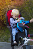 Father and son traveling on bicycle, child is sitting in a bike Royalty Free Stock Photo