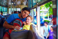 Father and son traveling in public bus through asian city Royalty Free Stock Images