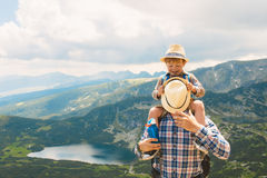Father and son traveling in Rila mountains Bulgaria Stock Photo