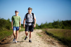 Father and son trekking Royalty Free Stock Image