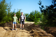 Father and son trekking Stock Photos