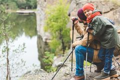 Father and son trekking together royalty free stock image