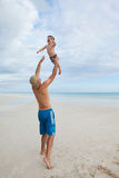 Father and son at the tropical beach. Stock Photos