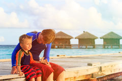 Father and son on tropical vacation Stock Image